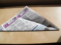 newspaper first fold unfolded