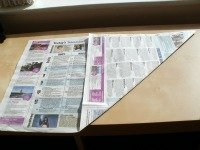 newspaper folded into a square