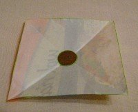 folded square with penny